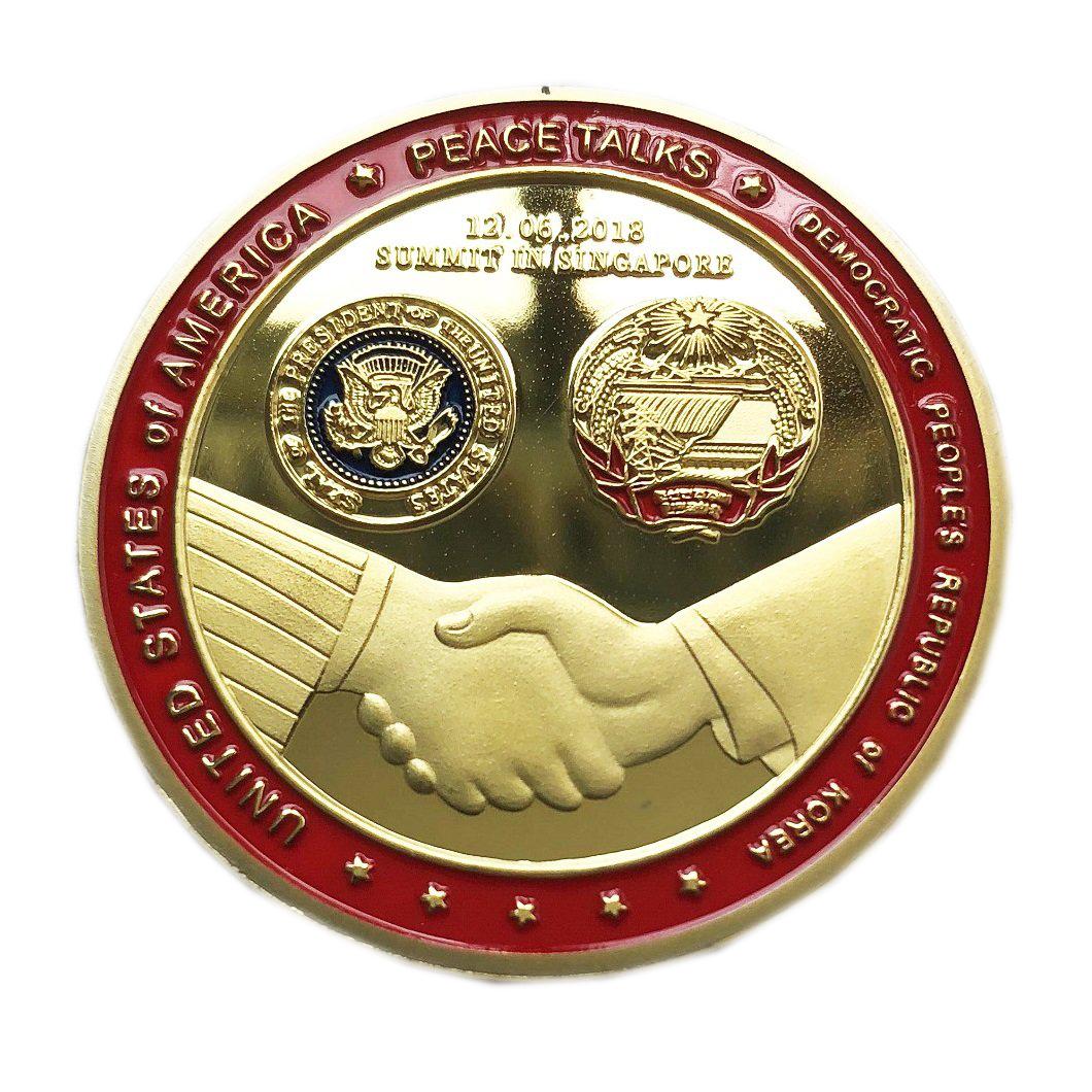 trump and kim jong un coin